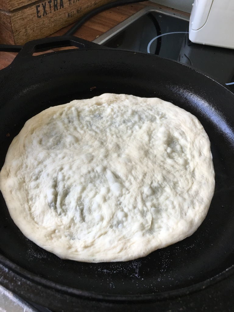 Baking pizza in cast-iron skillet